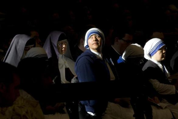 A nun looks on as Pope Benedict XVI leads the Epiphany mass in Saint Peter Basilica at the Vatican January 6, 2010.