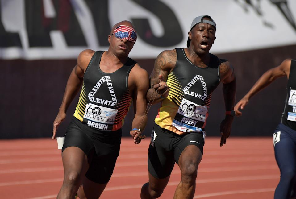 David Brown (left) runs with guide Jerome Avery in the visually impaired paralympic 200m during the 60th Mt. San Antonio College Relays at Murdock Stadium.