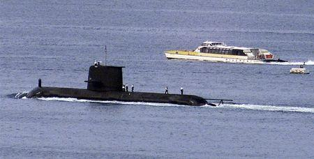 File photo of a Rivercat ferry passing by the Royal Australian Navy's newest Collins class submarine