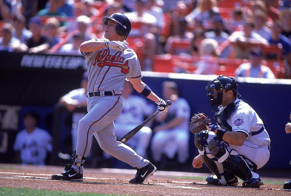 23 Sep 2001:  Second baseman Marcus Giles #24 of the Atlanta Braves swings while cather Mike Piazza #31 of the New York Mets crouches behind the plate during the Major League Baseball game at Shea Stadium in Flushing, New York.  The Braves came from behind to defeat the Mets 5-4. Mandatory Credit:  Al Bello/Allsport