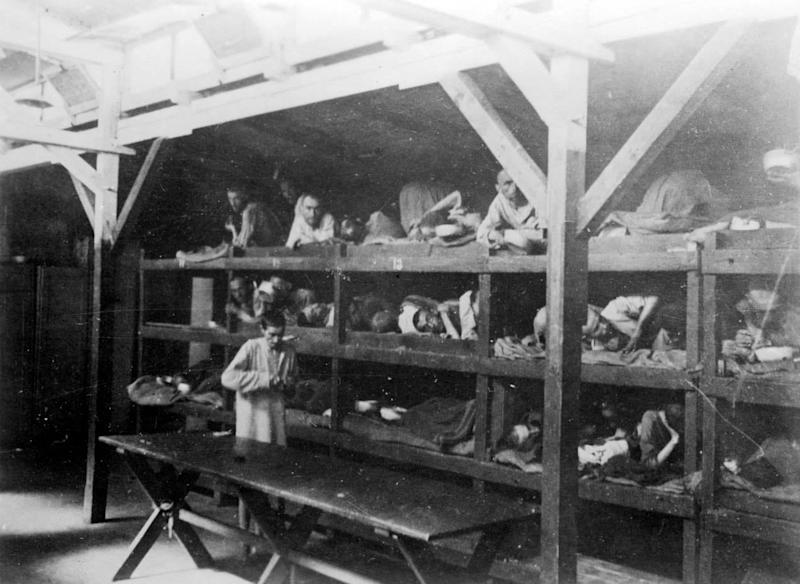 Inmates lying on bunks after liberation (Reuters Pictures Archive).JPG
