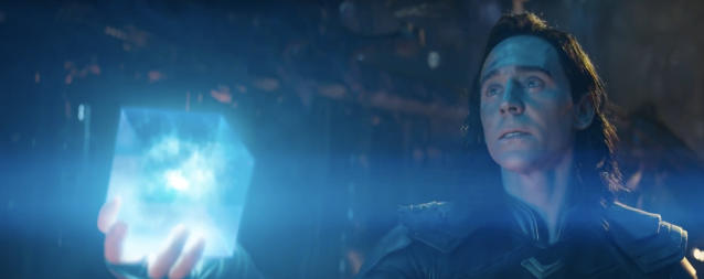 Loki appears to offer the Tesseract, aka the Space Stone, to Thanos. (Photo: Marvel Studios)