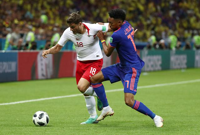Soccer Football - World Cup - Group H - Poland vs Colombia - Kazan Arena, Kazan, Russia - June 24, 2018 Poland's Bartosz Bereszynski in action with Colombia's Johan Mojica REUTERS/Sergio Perez