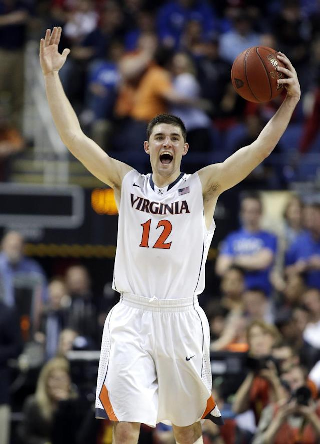 Virginia's Joe Harris (12) celebrates after defeating Duke in an NCAA college basketball game in the championship of the Atlantic Coast Conference tournament in Greensboro, N.C., Sunday, March 16, 2014. Virginia won 72-63. (AP Photo/Bob Leverone)