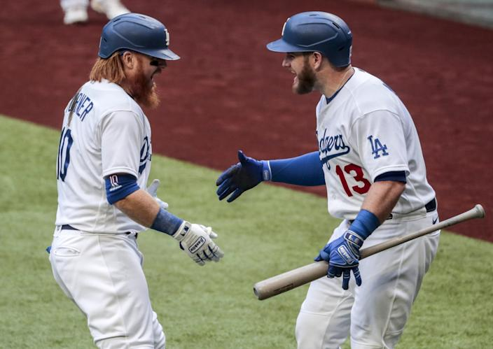 Dodgers third baseman Justin Turner celebrates with first baseman Max Muncy after hitting a home run in the first inning.