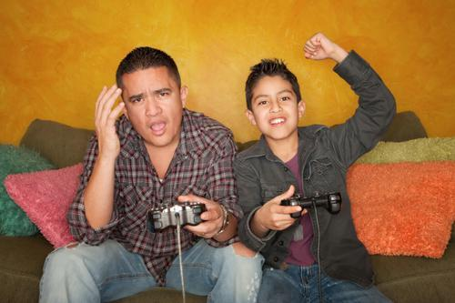 Father and son playing a video game