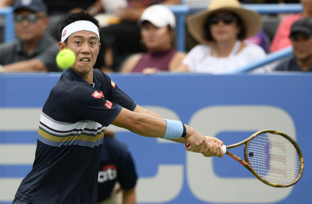 Kei Nishikori, of Japan, eyes the ball in a match against Alexander Zverev, of Germany, during the Citi Open tennis tournament, Friday, Aug. 3, 2018, in Washington. (AP Photo/Nick Wass)