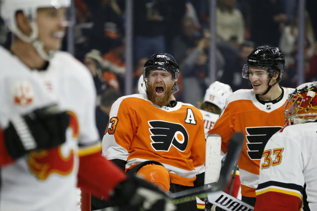 Philadelphia Flyers' Jakub Voracek (93) celebrates with Travis Sanheim (6) after scoring a goal against Calgary Flames' David Rittich (33) during the second period of an NHL hockey game, Saturday, Nov. 23, 2019, in Philadelphia. (AP Photo/Matt Slocum)