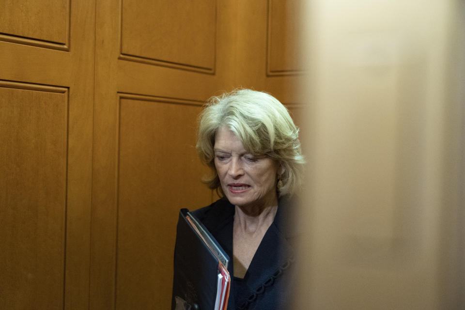 """FILE - In this Oct. 7, 2021, file photo, Sen. Lisa Murkowski, R-Alaska, stands in an elevator as she departs, on Capitol Hill, in Washington. A man described as a """"normal guy"""" who kept a low profile in his rural Alaska community faces charges he threatened to hire an assassin to kill the U.S. senator. Jay Allen Johnson was scheduled to be arraigned later Friday, Oct. 8, 2021, on charges related to phone threats authorities say he made against Murkowski. Johnson was arrested earlier in the week and was being held in a Fairbanks jail ahead of the federal court hearing. (AP Photo/Alex Brandon, File)"""