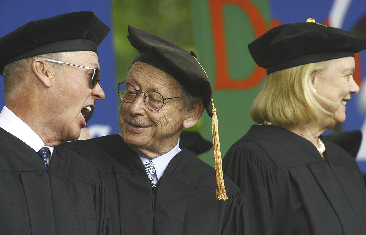 Actor and director Michael Keaton, left, reacts to a remark by Bernard Osher, founder and treasurer of the Osher Foundation, as they wait onstage to receive their honorary degrees at the Carnegie Mellon University commencement in Pittsburgh, Pa., Sunday, May 21, 2017. At right is Meg Whitman, president and CEO of Hewlett Packard Enterprise, who was the commencement speaker and also received an honorary degree (Larry Roberts/Post-Gazette via AP)