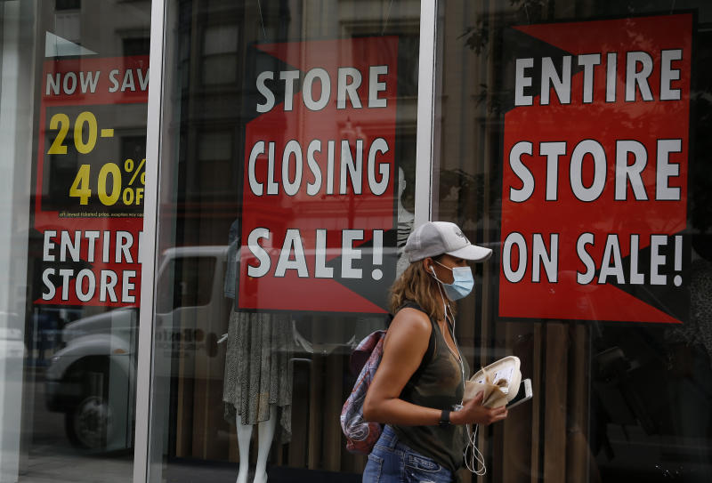 BOSTON - AUGUST 4: A pedestrian walks past the Lord and Taylor store in Boston on Aug. 4, 2020. Lord and Taylor, filing for bankruptcy, plans to close two Boston-area stores. The stores in the Prudential Center and the Natick Mall will be closing. (Photo by Jessica Rinaldi/The Boston Globe via Getty Images)