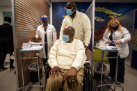 Baseball Hall of Famer Hank Aaron prepares to receive his COVID-19 vaccination on Tuesday, Jan. 5, 2021, at the Morehouse School of Medicine in Atlanta. Aaron and others received their vaccinations in an effort to highlight the importance of getting vaccinated for Black Americans who might be hesitant to do so. (AP Photo/Ron Harris)
