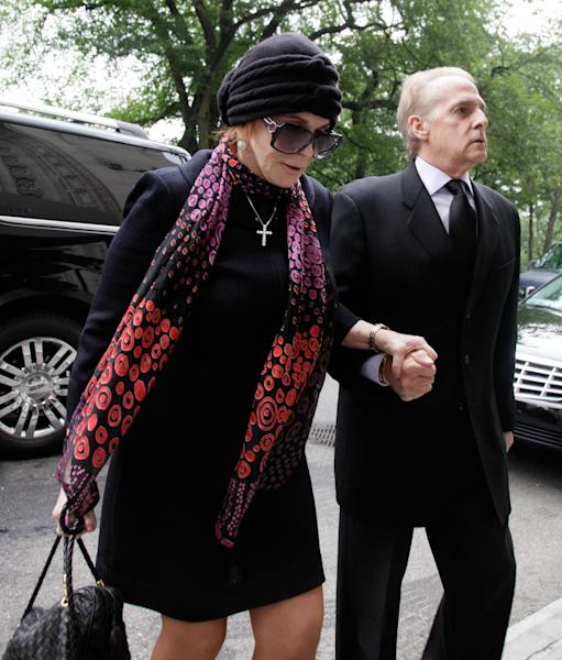 """Actress, singer and dancer Ann-Margret arrives for the funeral of Marvin Hamlisch, in New York's Temple Emanu-El, Tuesday, Aug. 14, 2012. Hamlisch composed or arranged hundreds of scores for musicals and movies, including """"A Chorus Line"""" on Broadway and the films """"The Sting,"""" ''Sophie's Choice,"""" ''Ordinary People"""" and """"The Way We Were."""" He won three Oscars, four Emmys, four Grammys, a Tony, a Pulitzer and three Golden Globes. Hamlisch died Aug. 6 in Los Angeles at age 68. (AP Photo/Richard Drew)"""