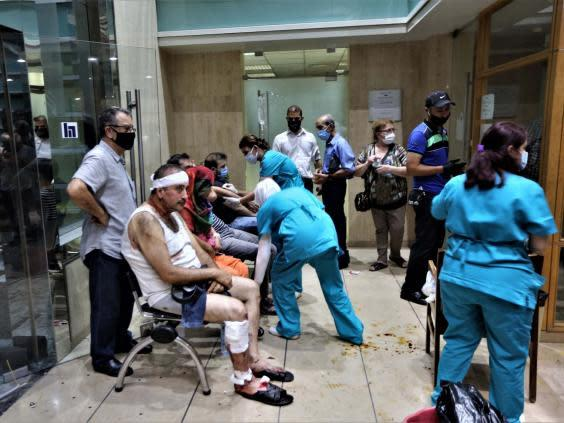 People injured in the Beirut Port explosion receive first aid at Najjar Hospital in Al-Hamra area (EPA)