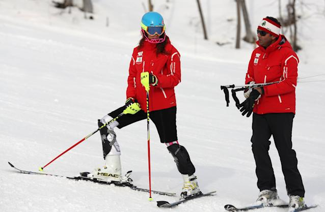 Lebanon's Jacky Chamoun, left, trains for the women's slalom at the Alpine ski venue at the Sochi 2014 Winter Olympics, Thursday, Feb. 20, 2014, in Krasnaya Polyana, Russia. (AP Photo/Alessandro Trovati)