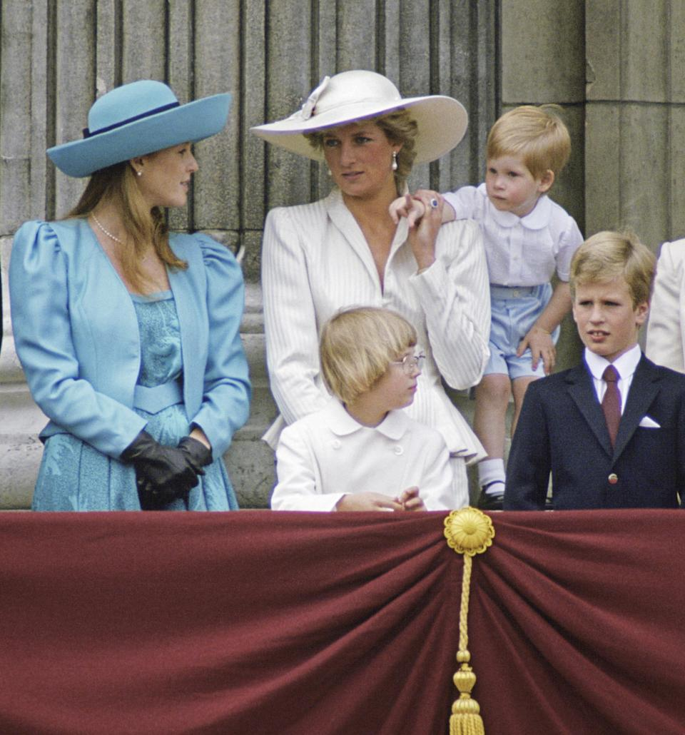 Sarah Ferguson donned eighties power shoulders and leather gloves on the Buckingham Palace balcony in 1987 while sister-in-law, Princess Diana, donned head-to-toe pink. (Getty Images)