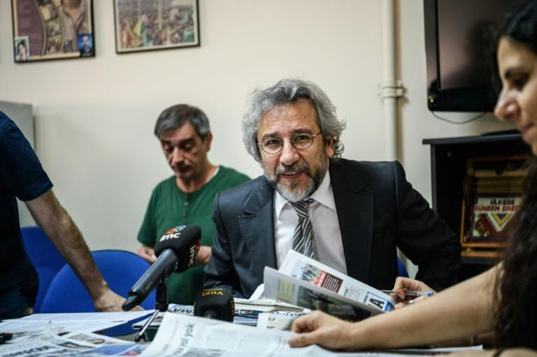 Cumhuriyet Daily newspaper Editor-in-chief Can Dundar (C), pictured during a meeting in 2016, was handed a five-year-and-10-month jail term and has now fled Turkey for Germany
