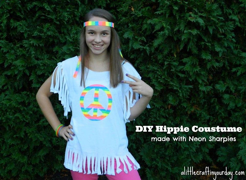 "<p>Talk about a bright idea! This colorful costume was made using a plain T-shirt, neon Sharpie markers, and a stencil. </p><p><strong>Get the tutorial at <a href=""https://alittlecraftinyourday.com/2013/10/16/hippie-halloween-costume/"" rel=""nofollow noopener"" target=""_blank"" data-ylk=""slk:A Little Craft In Your Day"" class=""link rapid-noclick-resp"">A Little Craft In Your Day</a>.</strong> </p><p><a class=""link rapid-noclick-resp"" href=""https://www.amazon.com/Sharpie-Electro-Permanent-Markers-Assorted/dp/B00UHUKKHQ/ref=sr_1_2?tag=syn-yahoo-20&ascsubtag=%5Bartid%7C10050.g.28305469%5Bsrc%7Cyahoo-us"" rel=""nofollow noopener"" target=""_blank"" data-ylk=""slk:SHOP SHARPIE MARKERS"">SHOP SHARPIE MARKERS</a></p>"