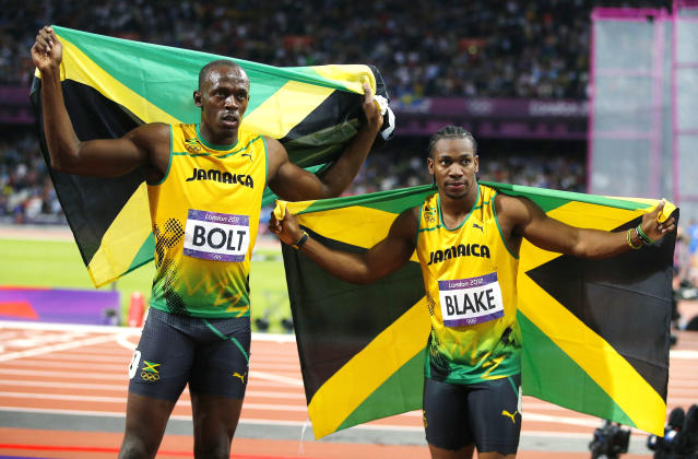 Jamaica's Usain Bolt (L) celebrates winning with countryman Yohan Blake who took second in the men's 100m final during the London 2012 Olympic Games at the Olympic stadium in London August 5, 2012. REUTERS/Brian Snyder (BRITAIN - Tags: SPORT ATHLETICS SPORT OLYMPICS)