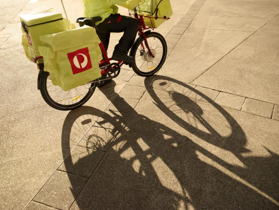 A photo of an Australian Post postie on a delivery bike. Source: Australia Post