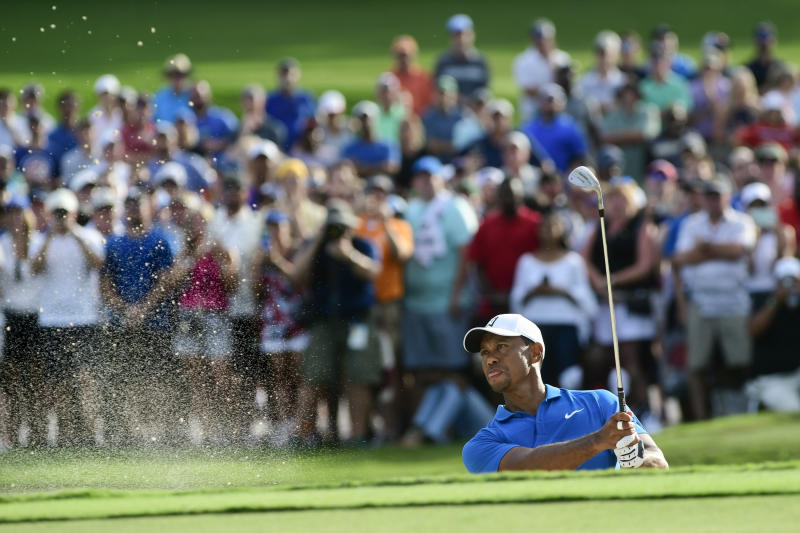 Tiger Woods hits out of the sand to the 15th green during the third round of the Tour Championship golf tournament Saturday, Sept. 22, 2018, in Atlanta. (AP Photo/John Amis)