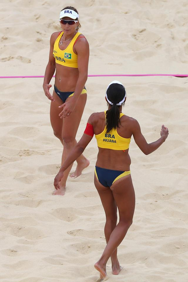 LONDON, ENGLAND - JULY 28: Larissa Franca (R) and Juliana Silva of Brazil in action during the Women's Beach Volleyball Preliminary Round on Day 1 of the London 2012 Olympic Games at Horse Guards Parade on July 28, 2012 in London, England. (Photo by Ryan Pierse/Getty Images)