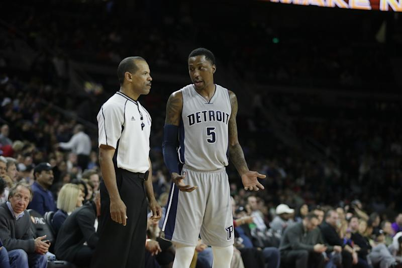Detroit Pistons guard Kentavious Caldwell-Pope talks with NBA official Eric Lewis during a March 2017 game. (AP)