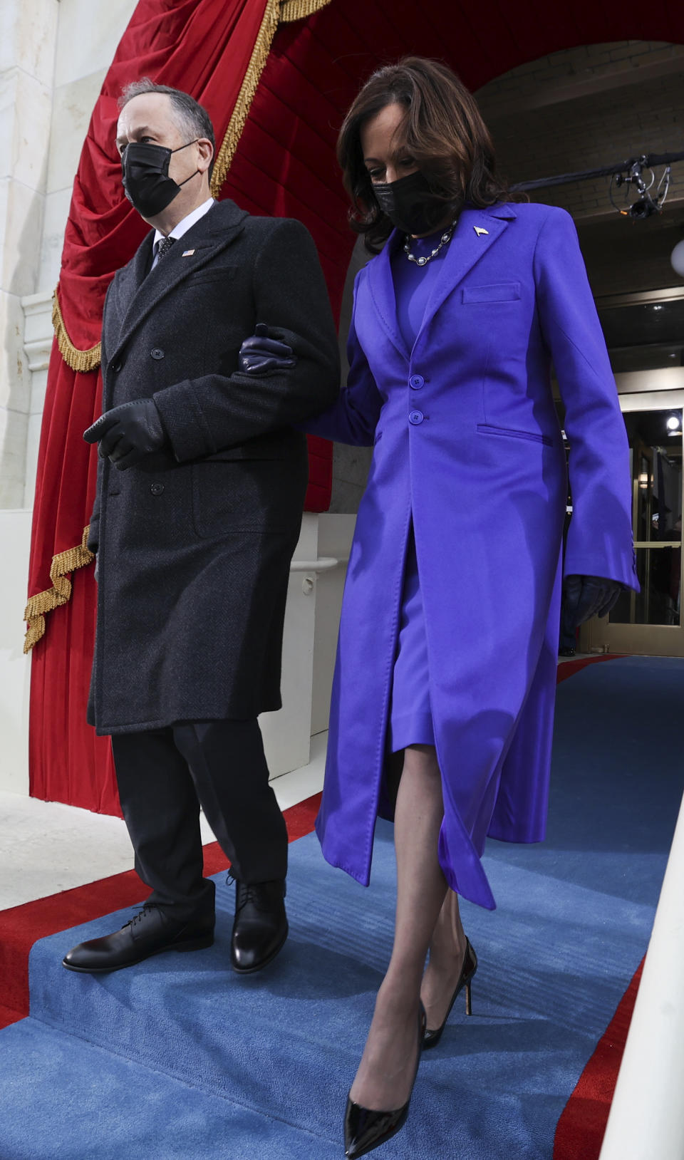 US Vice President-elect Kamala Harris and her spouse Doug Emhoff arrive for the inauguration. (Photo: Jonathan Ernst/APF via Getty Images)