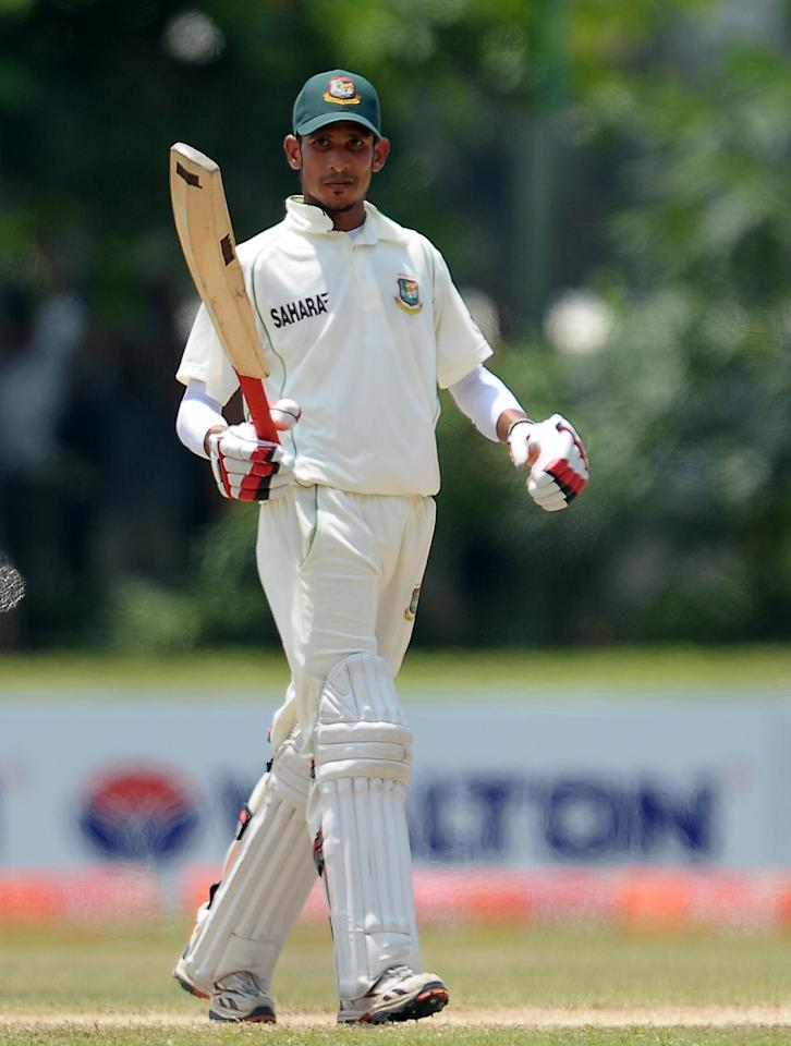 Bangladeshi cricketer Nasir Hossain raises his bat to the crowd after scoring a half-century (50 runs) during the fourth day of the opening Test match between Sri Lanka and Bangladesh at the Galle International Cricket Stadium in Galle on March 11, 2013. AFP PHOTO/ LAKRUWAN WANNIARACHCHI        (Photo credit should read LAKRUWAN WANNIARACHCHI/AFP/Getty Images)