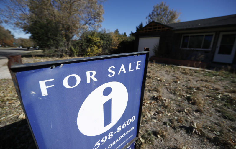 FILE - In this Oct. 22, 2019, file photo a sign stands outside a home for sale in southeast Denver. On Thursday, Dec. 5, Freddie Mac reports on this week's average U.S. mortgage rates. (AP Photo/David Zalubowski)