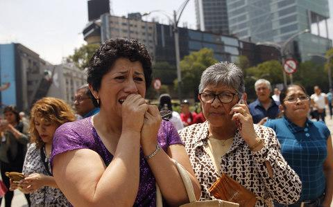 <p>Mexico was struck by a powerful earthquake on Tuesday that killed at least 217 people and toppled several buildings in the capital. The death toll, announced by the interior minister shortly midnight, climbed throughout the night as rescue workers continued digging through rubble, with 21 children at a collapsed primary school among those killed. </p>