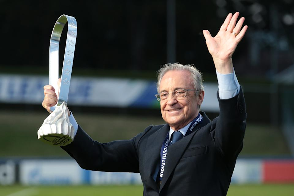 Real Madrid President Florentino Perez (pictured) with the trophy following Madrid's 3-2 victory in the UEFA Youth League Final.