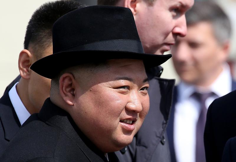 Kim Jong Un, North Korea's leader, reacts while watching an honor guard before his departure to North Korea at the railway station in Vladivostok, Russia, on Friday, April 26, 2019. Kim said the summit will be a starting point for productive talks on cooperation, Vesti TV reported him as saying in an interview. Photographer: Andrey Rudakov/Bloomberg via Getty Images