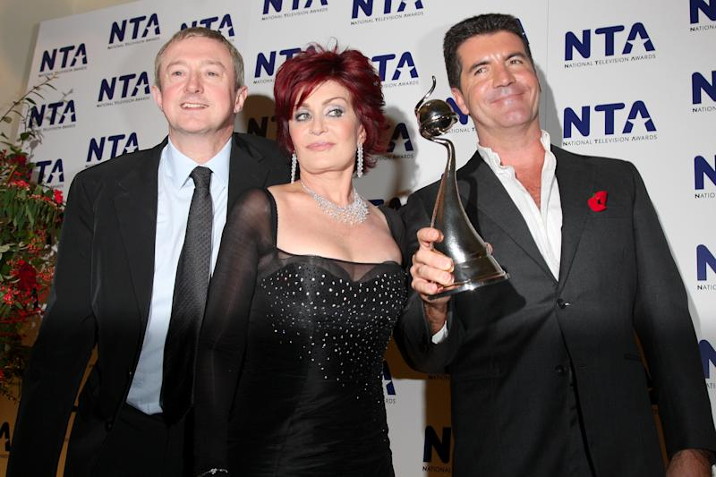 "LONDON - OCTOBER 31: Members of the ""The X Factor"" Louis Walshe, Sharon Osbourne and Simon Cowell pose with the award for Most Popular Talent Show at the National Television Awards 2007 held at the Royal Albert Hall on October 31, 2007 in London, England. (Photo by Jon Furniss/WireImage)"