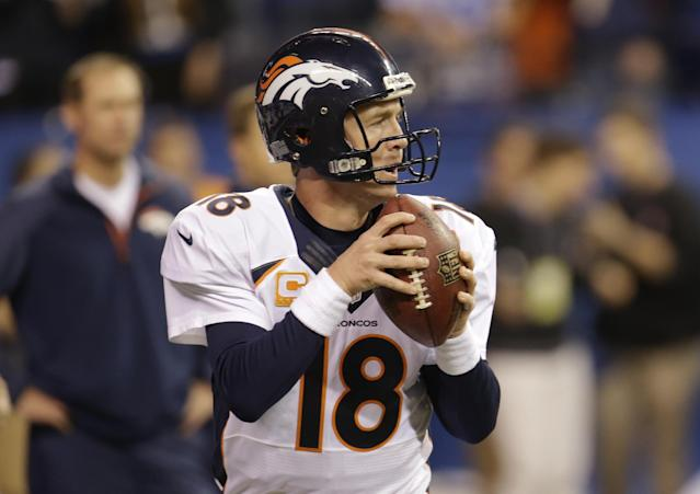 Denver Broncos quarterback Peyton Manning (18) warms up before an NFL football game against the Indianapolis Colts, Sunday, Oct. 20, 2013, in Indianapolis. (AP Photo/AJ Mast)