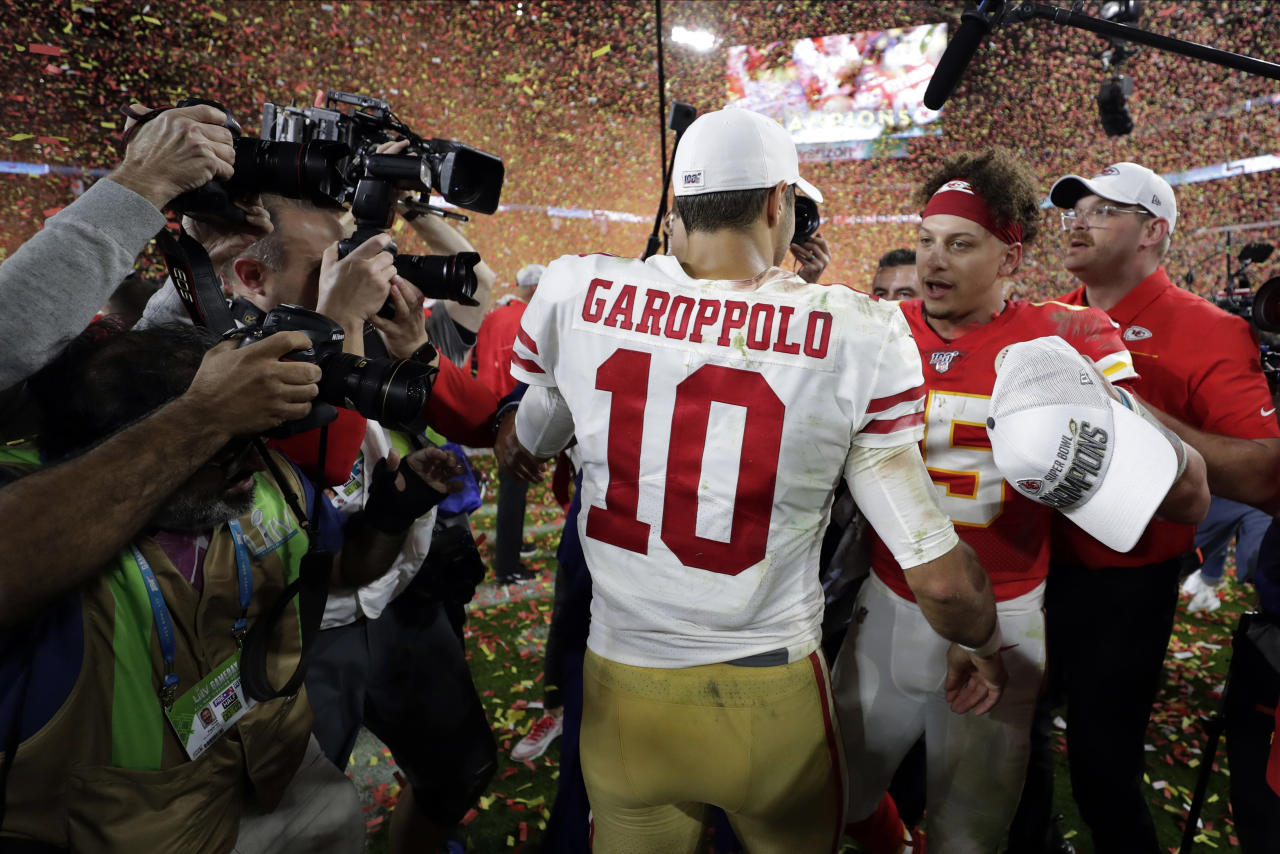 Kansas City Chiefs' quarterback Patrick Mahomes, right, speaks to San Francisco 49ers' quarterback Jimmy Garoppolo after winning the NFL Super Bowl 54 football game Sunday, Feb. 2, 2020, in Miami Gardens, Fla. (AP Photo/Matt York)