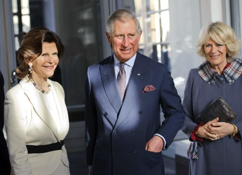 Britain´s Prince Charles, centre, and Camilla, Duchess of Cornwall, right, are received by Sweden's Queen Silvia at Stockholm Royal Palace Thursday March 22, 2012. (AP Photo/Scanpix, Henrik Montgomery) SWEDEN OUT