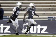 Penn State wide receiver Jahan Dotson (5) celebrates after returning a punt for a touchdown during the third quarter of NCAA college football game against Michigan State in State College, Pa., on Saturday, Dec. 12, 2020. Penn State won 39-24. (AP Photo/Barry Reeger)