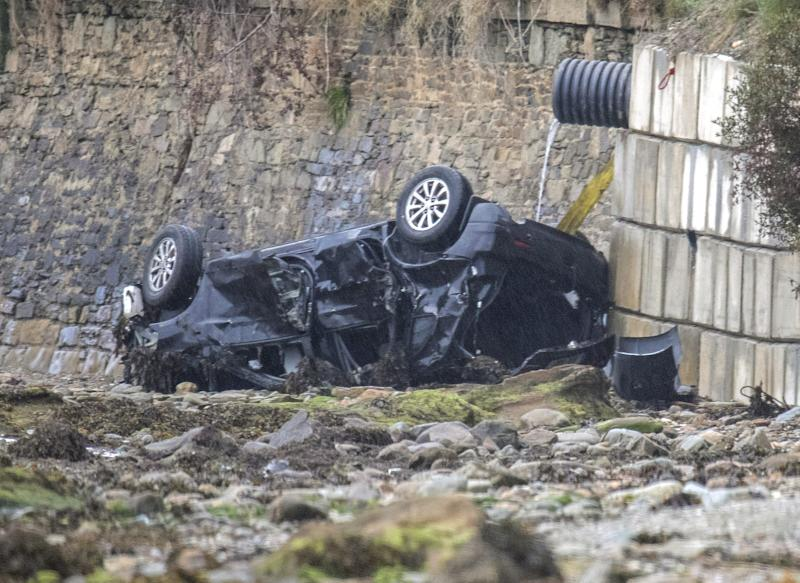 The wreckage of the car in which three people lost their lives in. (PA)