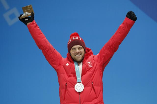 Medals Ceremony - Freestyle Skiing - Pyeongchang 2018 Winter Olympics - Men's Ski Cross - Medals Plaza - Pyeongchang, South Korea - February 21, 2018 - Silver medalist Marc Bischofberger of Switzerland on the podium. REUTERS/Eric Gaillard