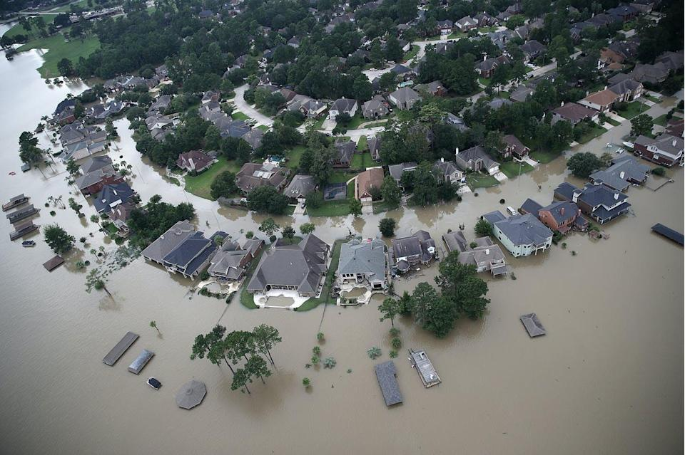 """<span class=""""caption"""">A '100-year flood' doesn't mean you'll be flood-free for the next 99 years.</span> <span class=""""attribution""""><a class=""""link rapid-noclick-resp"""" href=""""https://www.gettyimages.com/detail/news-photo/flooded-homes-are-shown-near-lake-houston-following-news-photo/841052402"""" rel=""""nofollow noopener"""" target=""""_blank"""" data-ylk=""""slk:Win McNamee/Getty Images"""">Win McNamee/Getty Images</a></span>"""