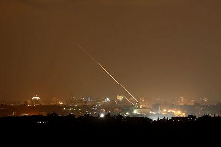 Streaks of light are pictured as rockets are launched from the northern Gaza Strip towards Israel, as seen from Sderot, Israel August 8, 2018. REUTERS/Amir Cohen