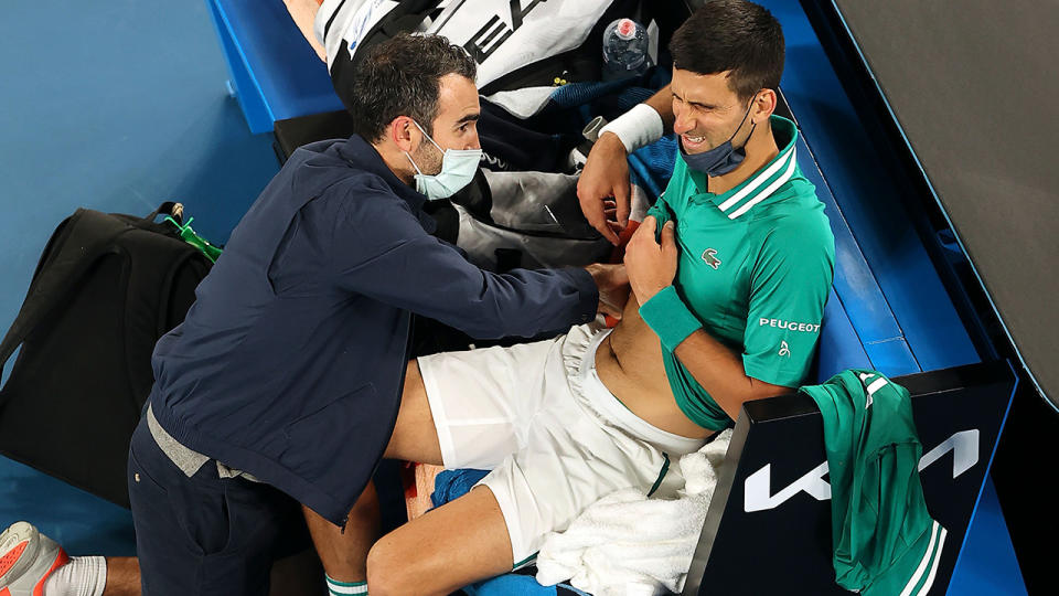 Novak Djokovic, pictured here during a medical timeout against Taylor Fritz at the Australian Open.