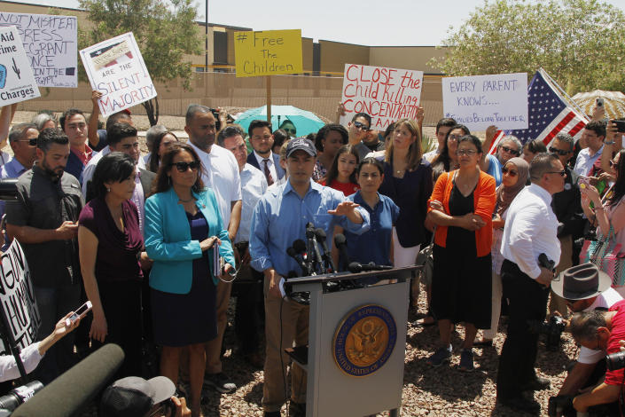 Rep. Joaquin Castro alongside members of the Hispanic Caucus after touring the Border Patrol station in Clint, Texas, on July 1. Castro's identical twin, presidential candidate Julián Castro, held a rally outside the building over the weekend. (Photo: AP/Cedar Attanasio)