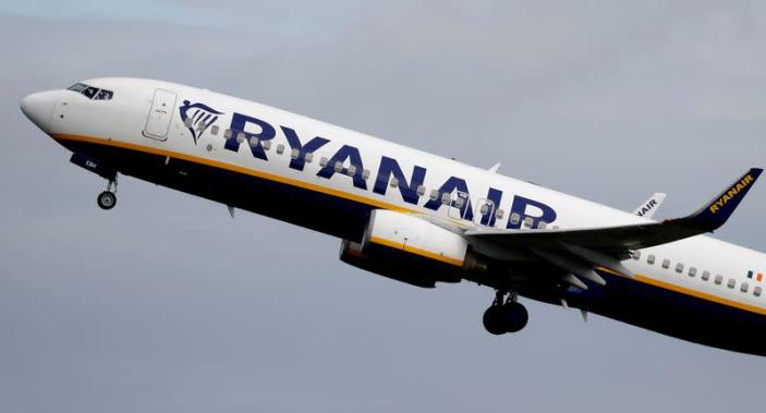 FILE PHOTO: A Ryanair plane takes off from Manchester Airport as the spread of the coronavirus disease (COVID-19) continues in Manchester