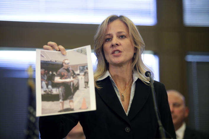 FBI specIal agent in charge, Teresa Carlson holds a photograph of a subject that the FBI wants to interview and is asking for any information as she speaks at a press conference on the shooting at the Sikh Temple of Wisconsin where yesterday a gunman fired upon people at service August, 6, 2012 in Oak Creek, Wisconsin. At least six people were killed when the shooter identified as Wade Michael Page opened fire on congregants in the Milwaukee suburb. The suspect who was a United States Army veteran was shot dead in a shootout with police. (Photo by Darren Hauck/Getty Images)