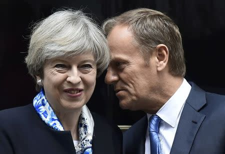 Britain's Prime Minister, Theresa May, greets Donald Tusk, the President of the European Council, outside 10 Downing Street, in central London, Britain April 6, 2017.       REUTERS/Hannah McKay