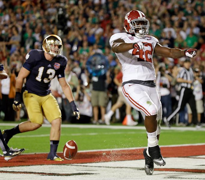 Alabama's Eddie Lacy (42) reacts after rushing for a touchdown during the first half of the BCS National Championship college football game against Notre Dame Monday, Jan. 7, 2013, in Miami. (AP Photo/David J. Phillip)