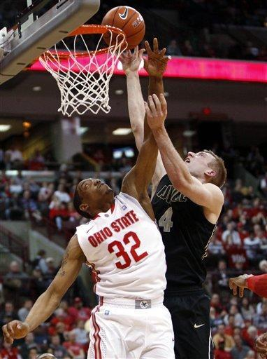 Ohio State's Lenzelle Smith Jr. (32) and Purdue's Robbie Hummel (4) reach for a rebound during the first half of an NCAA college basketball game, Tuesday, Feb. 7, 2012, in Columbus, Ohio. (AP Photo/Terry Gilliam)
