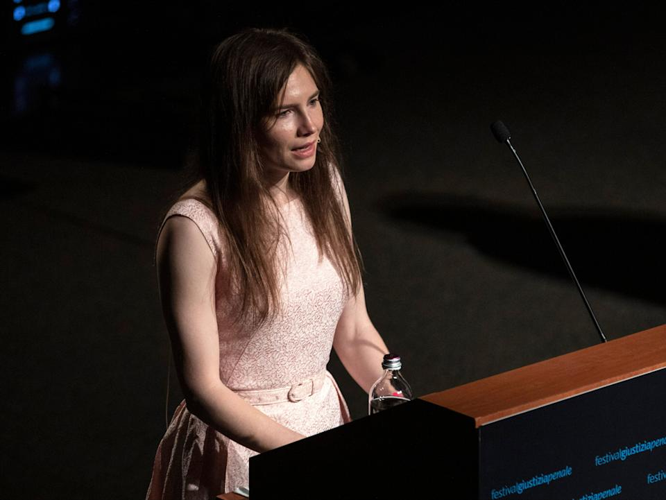 <p>Amanda Knox delivers a speech during the Criminal Justice Festival, an event organised by The Italy Innocence Project and the local association of barristers, on 15 June 2019 in Modena</p> (Getty)